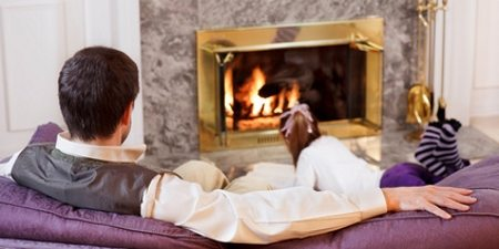 Gas Fire Servicing in Swadlincote & Burton on Trent - image of family by fireside - safely enjoying time together