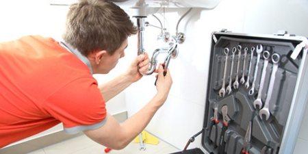 plumber in Swadlincote installing a new bathroom sink