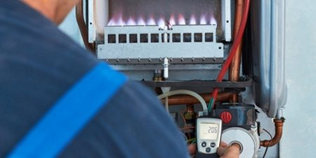 Gas Appliance Servicing in Swadlincote. Plumber and Gas Safe registered engineer servicing a gas boiler
